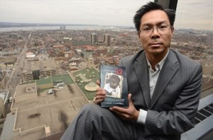 Thanh Campbell (Image holding book)