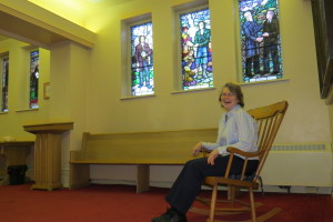 Nancy Gordon laughs as she sits in the rocking chair inside the BSUC's narthax.